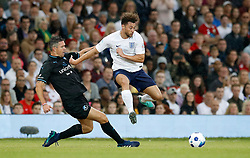 England's Myles Stephenson (right) battles for the ball with World XI's Kevin Pietersen (left) during the UNICEF Soccer Aid match at Old Trafford, Manchester. PRESS ASSOCIATION Photo. Picture date: Sunday June 10, 2018. See PA story SOCCER Aid. Photo credit should read: Martin Rickett/PA Wire.
