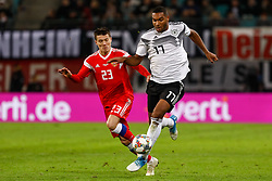November 16, 2018 - Leipzig, Germany - Jonathan Tah (R) of Germany and Dmitri Poloz of Russia vie for the ball during the international friendly match between Germany and Russia on November 15, 2018 at Red Bull Arena in Leipzig, Germany. (Credit Image: © Mike Kireev/NurPhoto via ZUMA Press)