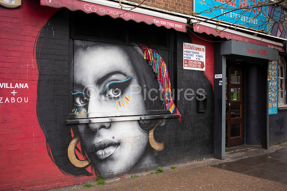 Street art mural to the deceased pop singer Amy Winehouse in London, United Kingdom. Amy Winehouse, 27, was found dead at her London home following years of drug and alcohol abuse largely attributed to her troubled character and fame.