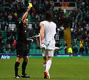 16.03.2013 Glasgow, Scotland.   Georgios Samaras is booked for removing his top during the celebration  during the Clydesdale Bank Premier League match between, Celtic and Aberdeen, from Celtic Park Stadium.