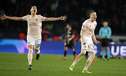 Manchester United's Diogo Dalot (left) and Scott McTominay celebrate after the final whistle during the UEFA Champions League match at the Parc des Princes, Paris, France.