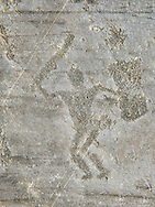 Petroglyph, rock carving, of a warrior with a sword and a square shiled. Carved by the ancient Camuni people in the iron age between 1000-1600 BC. Rock no 24,  Foppi di Nadro, Riserva Naturale Incisioni Rupestri di Ceto, Cimbergo e Paspardo, Capo di Ponti, Valcamonica (Val Camonica), Lombardy plain, Italy .<br /> <br /> Visit our PREHISTORY PHOTO COLLECTIONS for more   photos  to download or buy as prints https://funkystock.photoshelter.com/gallery-collection/Prehistoric-Neolithic-Sites-Art-Artefacts-Pictures-Photos/C0000tfxw63zrUT4<br /> If you prefer to buy from our ALAMY PHOTO LIBRARY  Collection visit : https://www.alamy.com/portfolio/paul-williams-funkystock/valcamonica-rock-art.html