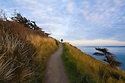 Liana Welty hikes the Bluff Trail in Fort Ebey State Park, Whidbey Island, Washington, with views over Puget Sound.