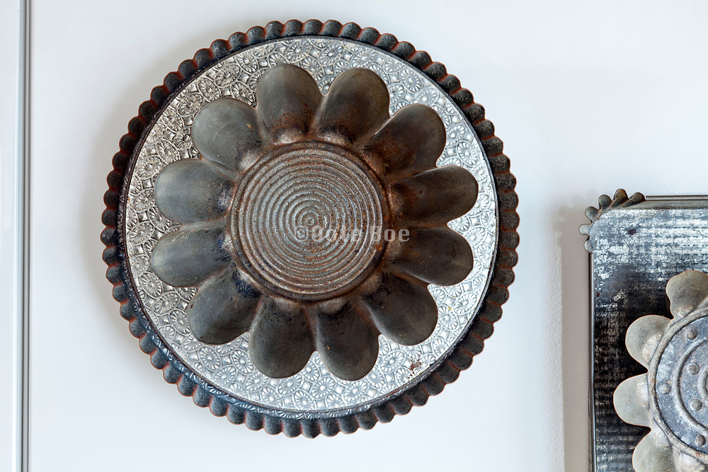various old style metal tart and pie baking pans