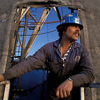 Canada, British Columbia, Dale Leitner watches sunset  from oil rig near Fort St. John