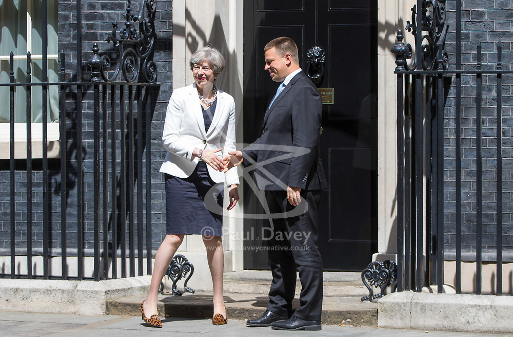 London, July 18th 2017. In a clear demonstration of unity with a cabinet that has seemed to be split over Brexit and other issues,  Government ministers, L-R \\ leave the last cabinet meeting together before the Parliamentary summer recess at Downing Street in London.