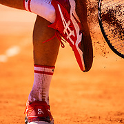 PARIS, FRANCE June 13.   Novak Djokovic of Serbia cleans the clay from his tennis shoes during his match against Stefanos Tsitsipas of Greece on Court Philippe-Chatrier during the final of the singles competition at the 2021 French Open Tennis Tournament at Roland Garros on June 13th 2021 in Paris, France. (Photo by Tim Clayton/Corbis via Getty Images)