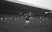 Kerry player jumps high above Westmeath player in an attempt to grab the ball during the All Ireland Minor Gaelic Football Final Kerry v. Westmeath in Croke Park on the 22nd September 1963.