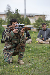 © Licensed to London News Pictures. 30/03/2015. Erbil, Iraq. A peshmerga sniper practices judging distances using the scope on his Romanian PSL sniper rifle during a training package run by coalition forces instructors at a military training area near Erbil, Iraq.<br /> <br /> The training is part of a four week long package, the first to be held with a complete peshmerga battalion, run by coalition forces mobile training teams (MTT) in Kurdistan with the aim to make the peshmerga more efficient in combatting the Islamic State. Photo credit: Matt Cetti-Roberts/LNP