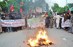 August 29, 2017 - Hyderabad, Sindh, Pakistan - Activities of Pakistan Thereek e Insaf shouts during the protest against US and India out side Hyderabad press club they also burns the flags of US and India, (Credit Image: © Janali Laghari/Pacific Press via ZUMA Wire)