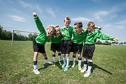 Young football team soccer shouting happy
