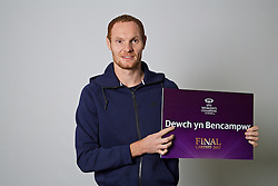 "CARDIFF, WALES - Monday, November 7, 2016: Wales' Shaun MacDonald holds up a board ""Dewch yn Bencampwr"" to encourage people to become volunteers for the 2017 UEFA Champions League Final in Cardiff. (Pic by David Rawcliffe/Propaganda)"