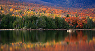 A Colorful And Pastoral Mountain Lake Scene On An Autumn Evening, Loon Lake, Adirondack Mountains, New York State, USA