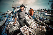 A fisherman surrounded by that day's catch in the famous port town in Cinque Terre.