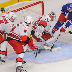 New York Rangers left wing Carl Hagelin (62) scores a goal on Carolina Hurricanes goalie Cam Ward (30) during third period NHL action between the Carolina Hurricanes and the New York Rangers at Madison Square Garden in New York, N.Y. The Rangers defeated the Hurricanes 4-2.