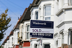 © Licensed to London News Pictures. 02/09/2020. London, UK. An estate agent's 'SOLD' board outside a property in north London. According to new figures released by Nationwide, UK houses prices were at an all-time high in August 2020 after their biggest monthly rise since 2004, as buyers took advantage of a stamp-duty holiday. The average sale price of a home jumped £3,188 to £224,123 in August. Photo credit: Dinendra Haria/LNP