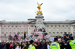 © Licensed to London News Pictures. 15/03/2019. LONDON, UK. Students crowd around the Queen Victoria Memorial by Buckingham Palace. Thousands of students take part in a Climate Change strike in Parliament Square, marching down Whitehall to Buckingham Palace.  Similar strikes by students are taking part around the world demanding that governments take action against the effects of climate change.  Photo credit: Stephen Chung/LNP