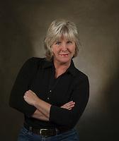 Headshots,- mature woman dark background.  ©2016 Karen Bobotas Photographer