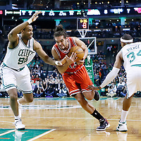 13 February 2013: Chicago Bulls center Joakim Noah (13) drives past Boston Celtics center Jason Collins (98) during the Boston Celtics 71-69 victory over the Chicago Bulls at the TD Garden, Boston, Massachusetts, USA.