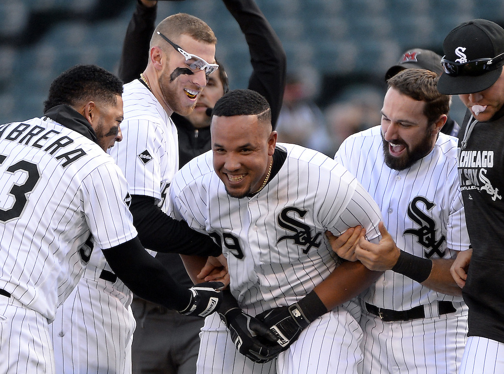 CHICAGO - APRIL 23:  Jose Abreu #79 of the Chicago White Sox celebrates with teammates after hitting a walk-off RBI single in the eleventh inning against the Texas Rangers on April 23, 2016 at U.S. Cellular Field in Chicago, Illinois.  The White Sox defeated the Rangers 4-3 in 11 innings.  (Photo by Ron Vesely)   Subject: Jose Abreu