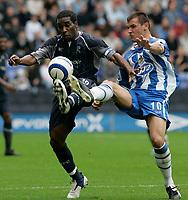 Photo: Dave Howarth.<br />Wigan Athletic v Bolton Wanderers. The Barclays Premiership. 02/10/2005. Lee McCullock battles Jay Jay Okocha