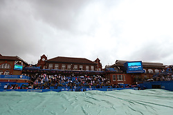 The covers are brought on as rain suspends play during day six of the 2017 AEGON Championships at The Queen's Club, London.