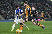 Andrew Robertson (Hull City) crosses the ball into the box during an attack in the final minutes of the game during the Sky Bet Championship match between Hull City and Sheffield Wednesday at the KC Stadium, Kingston upon Hull, England on 26 February 2016. Photo by Mark P Doherty.