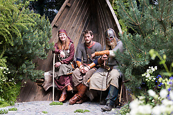 © Licensed to London News Pictures. 19/05/2014. London, England. Viking Cruises Norse Garden with actors portraying Vikings. Press Day at the RHS Chelsea Flower Show. On Tuesday, 20 May 2014 the flower show will open its doors to the public.  Photo credit: Bettina Strenske/LNP