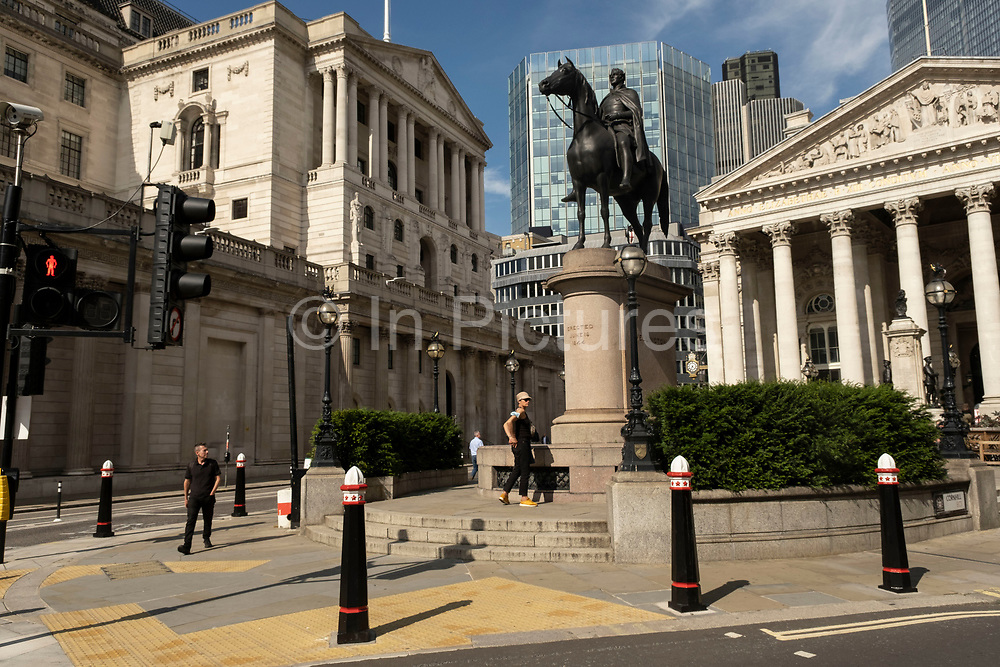 With very few people out and about the scene in the City of London financial district is one of quiet, outside the Royal Exchange near the Bank of England with the statue of the Duke of Wellington as the national coronavirus lockdown eases on 2nd July 2021 in London, United Kingdom. As the coronavirus lockdown continues its process of easing restrictions, the City remains far quieter than usual, which asks the question if normal numbers of people and city workers will ever return to the Square Mile.