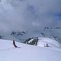 Amy Howat snowboards out of bounds near Mount Baker Ski Area, Washington.