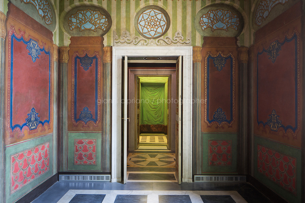 ROME, ITALY - 15 JULY 2015: The interior of the theatre of Villa Torlonia, where the majority of the decorations were made by Costantino Brumidi, the artist who painted the fresco in the Capitol building in Washington D.C., in Rome, Italy, on July 15th 2015.<br /> <br /> Villa Torlonia is a villa and surrounding gardens formerly belonging to the Torlonia family, a Roman noble family who acquired a huge fortune in the 18th and 19th centuries through administering the finances of the Vatican. In 1925 the Villa was given to Mussolini as a residence, where he remained until 1943, with few changes to the aboveground structures. Between 1942 and 1943 an air-raid shelter was first built in the garden of the villa, and then a much larger and more complex airtight bunker was built under the villa itself, with the intention of resisting both aerial bombardment and chemical warfare.