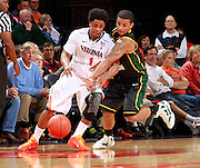 CHARLOTTESVILLE, VA- DECEMBER 6: Jontel Evans #1 of the Virginia Cavaliers reaches for a loose ball with Corey Edwards #13 of the George Mason Patriots during the game on December 6, 2011 at the John Paul Jones Arena in Charlottesville, Virginia. Virginia defeated George Mason 68-48. (Photo by Andrew Shurtleff/Getty Images) *** Local Caption *** Corey Edwards;Jontel Evans
