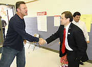 Tom Perriello, the Democratic nominee for US Representative from Virginia's 5th Congressional District, shakes hand with Howie Long, left, after casting his vote Tuesday at Meriwether Lewis elementary school in Ivy, VA.(Photo/Andrew Shurtleff)