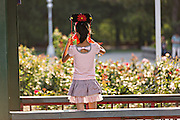 A young girl with a Chinese flag in Zhong Shan Park in Beijing, China