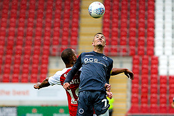 Jed Wallace of Millwall and Kyle Vassell of Rotherham United jump to head the ball - Mandatory by-line: Ryan Crockett/JMP - 26/08/2018 - FOOTBALL - Aesseal New York Stadium - Rotherham, England - Rotherham United v Millwall - Sky Bet Championship
