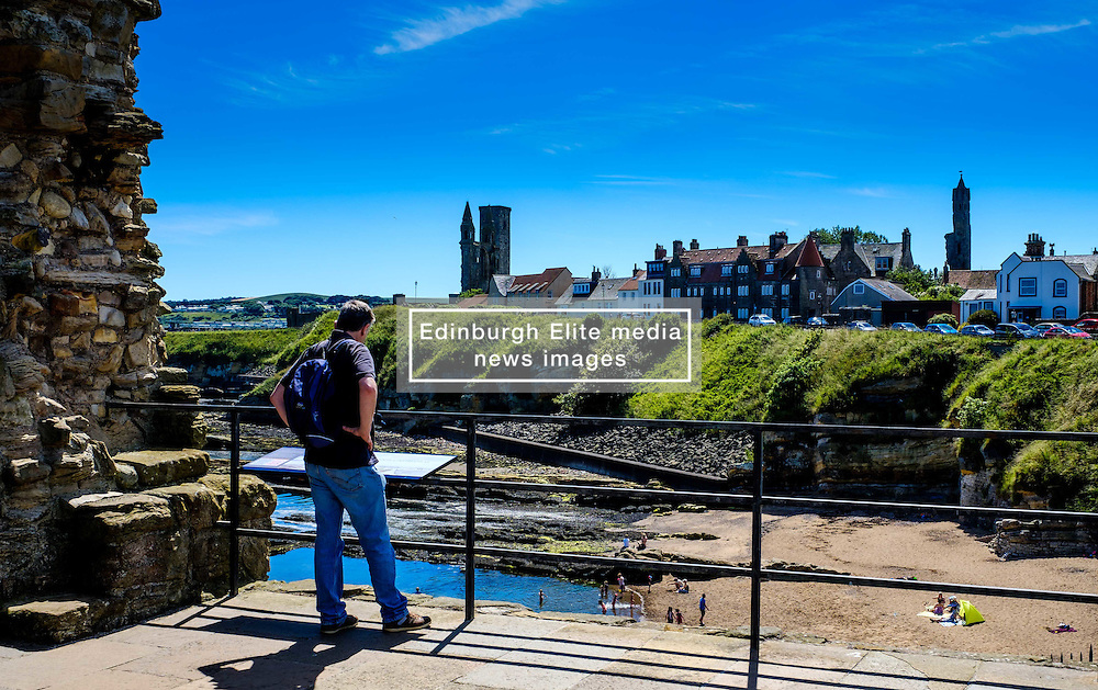 A tourist looks out from St Andrews Castle towards the cathedral on a hot summers day<br /> <br /> (c) Andrew Wilson | Edinburgh Elite media