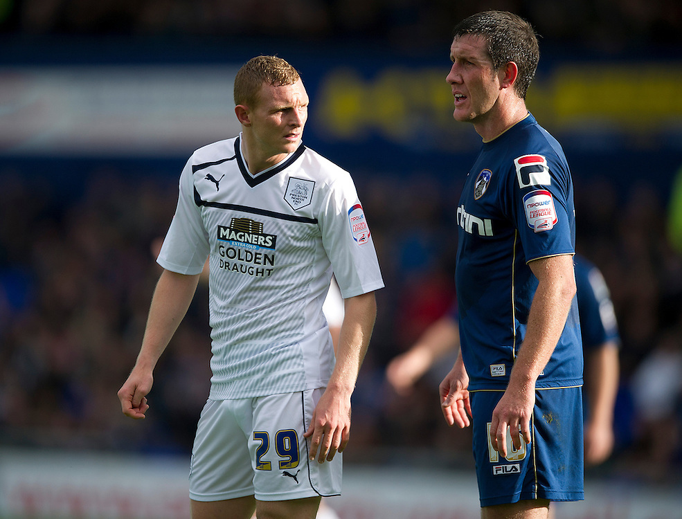 Preston North End's Stuart Beavon and Oldham Athletic's Cliff Byrne ..Football - npower Football League Division One - Oldham Athletic v Preston North End - Saturday 6th October 2012 - Boundary Park - Oldham..