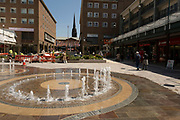 Upper Precinct Shopping Centre in the UK City of Culture 2021 on 23rd June 2021 in Coventry, United Kingdom. Coventrys Upper Precinct shopping area, once part of the post-war city centre pedestrianised zone has been under redevelopment since 2019, and now being revealed including water features. The UK City of Culture is a designation given to a city in the United Kingdom for a period of one year. The aim of the initiative, which is administered by the Department for Digital, Culture, Media and Sport. Coventry is a city which is under a large scale and current regeneration.
