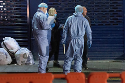 © Licensed to London News Pictures. 19/12/2020. London, UK. Forensic police working near a property on The Crescent in Southall where a body has been discovered. Neighbours had reported a a smelling odour for the last couple of weeks from the building. Photo credit: Ray Tang/LNP