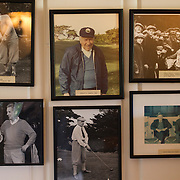 Old photos line the wall of the locker room at Cypress Point Golf Club in Pebble Beach, CA.