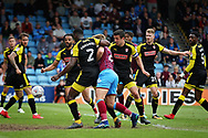 The scramble that lead to the Scunthorpe equaliser during the EFL Sky Bet League 1 match between Scunthorpe United and Rotherham United at Glanford Park, Scunthorpe, England on 12 May 2018. Picture by Nigel Cole.