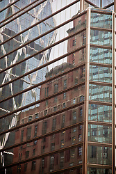 Reflection of old and new architecture on a glass building in New York City on the West Side