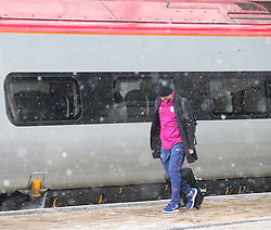 Pep Guardiola and The Manchester City team are seen at Manchester Piccadilly Train Station on Thursday morning as they make their trip to London to face Arsenal in the premier league