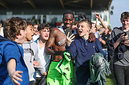 fans celebrate with Forest Green Rovers Isaiah Osbourne(34) during the EFL Sky Bet League 2 match between Forest Green Rovers and Chesterfield at the New Lawn, Forest Green, United Kingdom on 21 April 2018. Picture by Shane Healey.