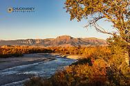 The Teton River with Ear Mountain in autumn at sunrise near Choteau, Montana, USA
