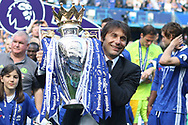 Chelsea Head Coach Antonio Conte poses with the Premier League Trophy. Premier league match, Chelsea v Sunderland at Stamford Bridge in London on Sunday 21st May 2017.<br /> pic by Steffan Bowen,  Andrew Orchard sports photography.
