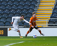 Hull City's Keane Lewis-Potter evades a challenge from Oxford United's Anthony Forde<br /> <br /> Photographer Lee Parker/CameraSport<br /> <br /> The EFL Sky Bet League One - Hull City v Oxford United - Saturday 13th March 2021 - KCOM Stadium - Kingston upon Hull<br /> <br /> World Copyright © 2021 CameraSport. All rights reserved. 43 Linden Ave. Countesthorpe. Leicester. England. LE8 5PG - Tel: +44 (0) 116 277 4147 - admin@camerasport.com - www.camerasport.com