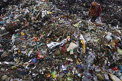 December 18, 2018 - Dhaka, Bangladesh - A woman scavenges recyclable materials from garbage for living near the Buriganga River. (Credit Image: © MD Mehedi Hasan/ZUMA Wire)