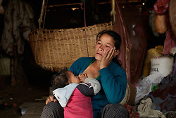 Niruta, now 24, breast feeds her youngest child, 11-month-old Kusum, inside their cow shed, where she spends the majority of her time caring for her children and animals. <br /> <br /> Niruta and Durga were married 9 years ago, when they were just 14 and 16 years old in the Kagati village of Nepal. The 2015 earthquakes devastated Nepal and left girls and women in an increasingly vulnerable position, leading experts to believe child marriage rates will increase over the coming years.