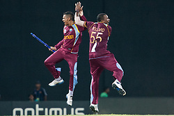 © Licensed to London News Pictures. 07/10/2012. West Indian players Sunil Narine and Kieron Pollard celebrate after winning the match during the World T20 Cricket Mens Final match between Sri Lanka Vs West Indies at the R Premadasa International Cricket Stadium, Colombo. Photo credit : Asanka Brendon Ratnayake/LNP